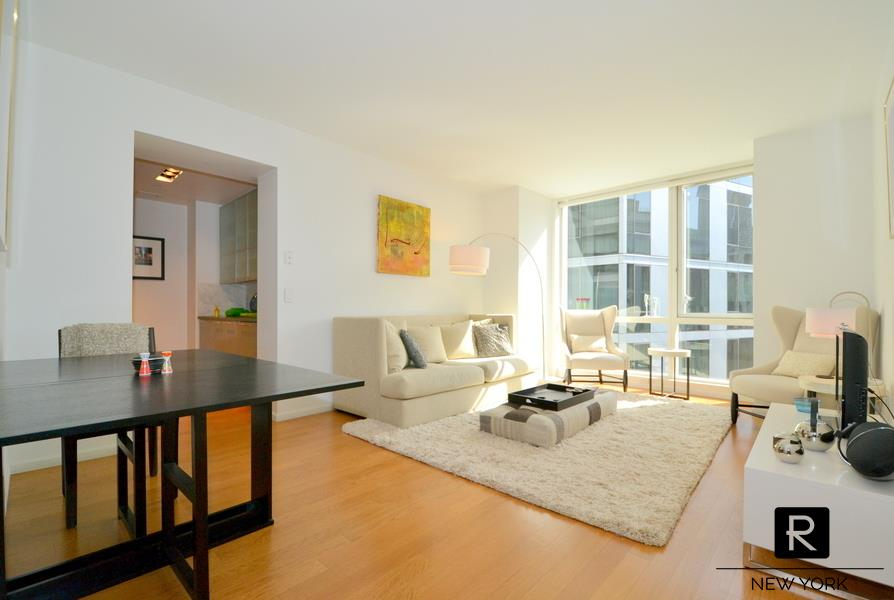 Extra Large 1 Bedroom facing East with Washer Dryer!Apartment features Hardwood Floors, Floor-to-Ceiling Windows, quiet East Exposure looking onto courtyard and up to blue skies.  Plenty of morning sunlight.  High end kitchen appliances including SubZero fridge, Viking stove, Bosch dishwasher.200 Chambers is a Full Service building with a Swimming Pool, Fitness Center, Residents' Lounge, Outdoor Terrace.  Close to 1/2/3/A/C/E subway trains, Whole Foods, Equinox, Barnes and Noble.  Restaurants in area include Marc Forgione, Locanda Verde, Tribeca Grill, Palm,  Shake Shack, Blue Smoke, Parm.NO FEE provided new lease starts by Apr 15 at the latest.