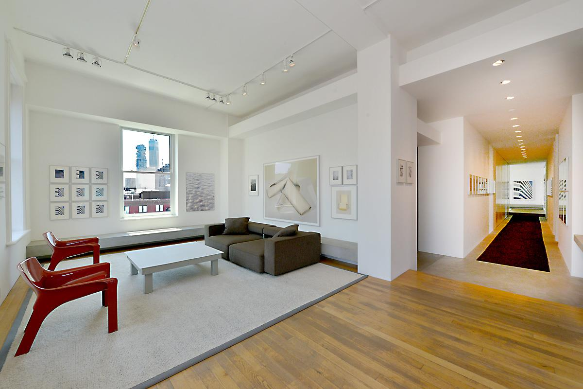 This high floor 4700 square foot 4 bedroom/4 bathroom condo loft has the most extraordinary natural light coupled with unobstructed panoramic  views to the North, South, East & West.  Located on one of the most desirable cobblestone Soho blocks, the New Museum Building is a pre-war loft building with 24 hour doorman/concierge, beautiful landscaped roof garden and is convenient to very best shopping, dining and transportation that one will find downtown…When the elevator opens directly into the loft, you will be greeted by 11' ceilings, a combination of solid oak and poured concrete floors, 18 oversized windows, grand entertaining spaces as well as intimate zen-like nooks for family and private time.  There is a central HVAC system, a Lutron system for lighting and shades and this home is pin-drop quiet.  There is  a wonderful separation between the public and private areas in this sprawling home...The expansive living and dining rooms have beautiful N/E & S exposures and seamlessly lead to the massive chef's kitchen.  Equipped with everything that a chef could ask for, the kitchen features Viking, Sub Zero, Jet Tech, Gaggenau and Ari-Less appliances.  The counter-tops are a combination of stainless steel and butcher block and also included are convection & regular ovens, auxiliary refrigeration drawers, industrial exhaust, wine storage, massive pantry, custom cabinetry and tucked away computer/desk work station. Simply put, this is a fabulous kitchen that is sure to be a central gathering space for family and friends alike to enjoy.Next, as you make your way down the dramatic gallery-type hallway to the bedroom wing, you will pass the full laundry room and large storage and utility closets, all of which are seamlessly hidden behind sleek walls of custom mill-work.  2 of the 3 family bedrooms have en-suite bathrooms and the 4th bedroom, the master suite features an en-suite bathroom as well.  All of the bedrooms have wonderful closet space and built in custom drawers