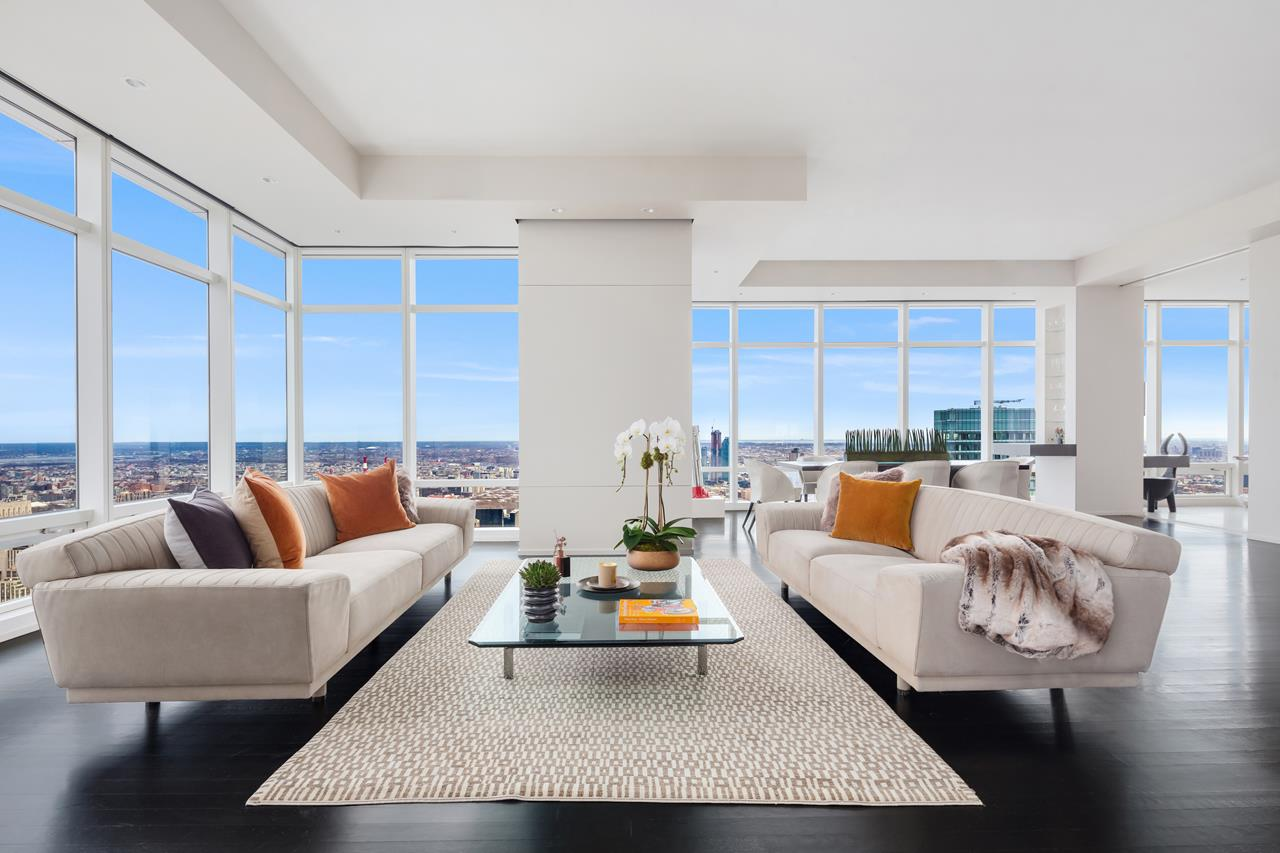 This stunning, 48th floor, three-bedroom, 3.5 bath corner home is now available at One Beacon Court. 48B offers breathtaking views of Central Park, the George Washington Bridge and both the Hudson and East rivers through floor to ceiling windows that span the entirety of the 2,669 square foot home.Masterfully renovated by renowned AD100 interior designer Suzanne Lovell, enter through the gracious foyer into the dramatic forty-foot corner great room perfect for entertaining with unbelievable views day and night.The fully equipped gourmet chefs kitchen is outfitted with Poggenpohl custom cabinetry, Italian Basaltina stone countertops, Brazilian Pannafragola granite floors, and professional series stainless steel appliances including Sub-Zero, Wolf and Miele. The adjoining banquet seating area is ideal for casual dining with a view.The master bedroom suite has spectacular Central Park views, an oversized bespoke walk-in closet / dressing room and a lavish marble bathroom equipped with a soaking tub, steam shower and bidet.Other features include 11-foot ceilings, a beautifully finished powder room, separate laundry room, and a Savant Home Automation System that controls all of the lighting, audio/visual, electric solar and black out shades and individually zoned central air throughout the home.Built in 2005 and designed by acclaimed Pelli Clarke Pelli Architects, One Beacon Court is one of Manhattans most prestigious full-service condominiums. In addition to the 24-hour doorman and private entry courtyard, amenities include personalized concierge services, a comprehensive fitness center with yoga facilities, entertainment lounge, childrens playroom and valet service.