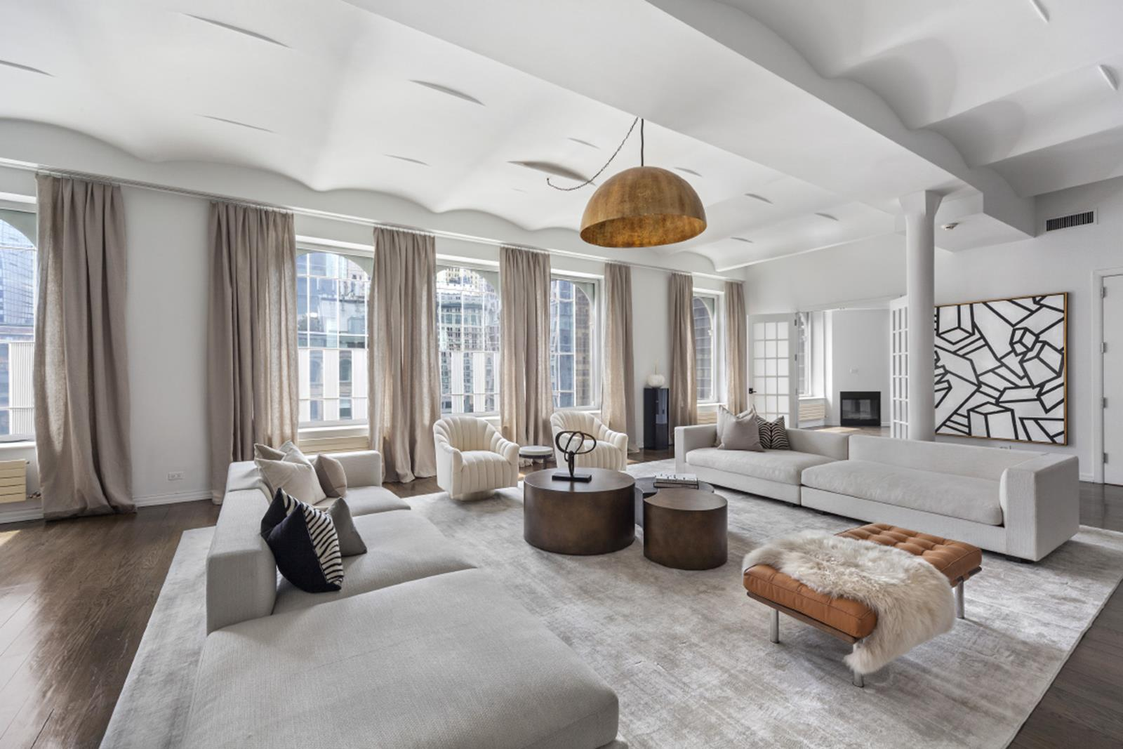 This Financial District's celebrated duplex condo Penthouse is now available for the first time in many years. With approx 7,175 sf of interior space and approx 3,500 sf of planted terraces, this is the ultimate downtown residence. A private landing leads you to phenomenal entertaining areas with soaring 12' ceilings, living room, dining room, screening room, huge chef's kitchen with breakfast room, library w/gas fireplace, 4 bedrooms, 4 full baths and a powder room. In addition there is a staff room with full bath, laundry room, and closets galore. Four exposures, barrel vaulted ceilings and handsome oak strip floors add to the uniqueness of this property. The grand circular and architectural staircase takes you to the upper level which houses the sun flooded grand master suite, two huge setback terraces, a very cozy den, a kitchenette and much more. One must visit this property and experience the captivating aura of light, views, grand scale and drama. Live in one of NYC's most vibrant neighborhoods. Schedule a viewing today. 1% Transfer Fee payable by buyer. Co-exclusive.