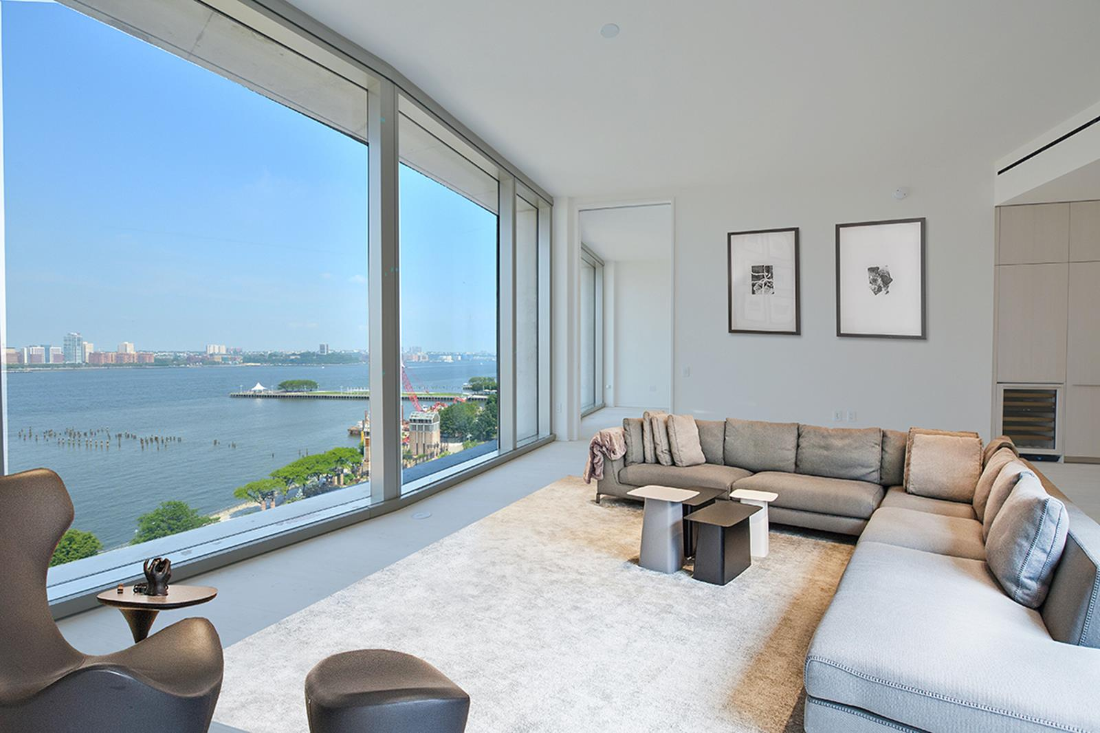 Highest floor 2-bedroom, 2.5 bathroom with spectacular Hudson River views. 1,644 SF / 153 SM with 70 linear feet of glass, 11-foot ceilings, 5 major art walls and unrivaled amenities. Conceptualized by Ian Schrager and designed by Herzog & de Meuron. Be the first to enjoy this truly special home. Apartment features: Semi private landing with only 2 apartments per floor. 12-inch wide-plank Scandinavian Larchwood floors throughout, floor-to-ceiling windows and 11 -foot ceilings. The oversized great room sits at the perfect elevation above the Hudson River and offers unobstructed River views all the way to The Statue of Liberty. The powder room is paneled in Scandinavian Larchwood and finished with a custom vanity. Bulthaup kitchen with Larchwood cabinets, Sivec marble slab countertops, backsplash and breakfast bar.  All appliances are fully integrated and include a Sub-zero refrigerator, Gaggenau cooktop, Wolf steam oven, Miele dishwasher, Sub-Zero wine refrigerator and a Miele coffee station. The master bedroom suite with Hudson River views has a dressing area and an oversized walk-in closet. The windowed en-suite master bath is fully clad in Sivec marble and offers a wet room with an oversized shower and Kaldewei soaking tub, double vanity and radiant heated floors. The large second bedroom is sun flooded and offers open Eastern views over the West Village. The en-suite 2nd bathroom has hand selected travertine stone walls, a large stall shower and a custom vanity with an integrated corian sink. California closets throughout the apartment. Motorized white solar shades in every room plus blackouts in both bedrooms. All lighting is on a dimming system plus multiple HVAC system zones. Vented washer and dryer. Triple pane windows with UVB/UVA protected glass. No pets. Separate storage room included. Building Features: A private cobblestone driveway, lush landscaped park by Madison Cox, professional spa with 70-foot pool, whirlpool, fitness center, yoga/pilates studio, steam room, sauna, massage room, club house with catering kitchen and a children's play room. 160 Leroy is situated on a cobblestone street in the heart of the West Village and is conveniently located across from The Hudson River Park and bike paths, steps to The Highline Park, Meatpacking District, home of the Whitney Museum, fabled Bleecker Street, and some of the city's best shopping and restaurants.NET EFFECTIVE RENT ADVERTISED. The advertised rent represents the NER on a 12 month lease with 1 month free.