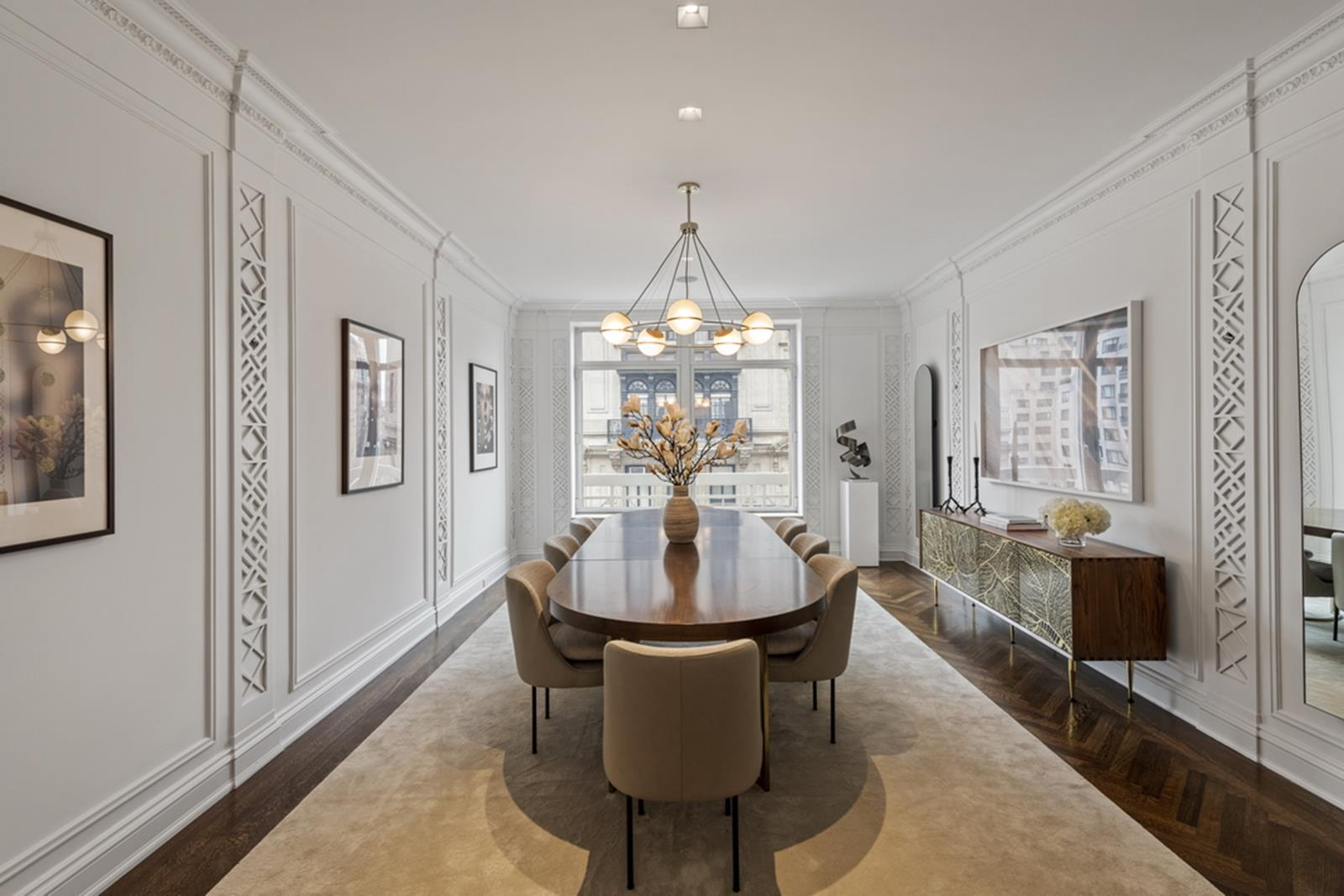 A palatial full floor condo overlooking Park Avenue, this Tony Ingrao-designed 6-bedroom, 6.5-bathroom home is a portrait of classic Manhattan luxury and style. Features of this 5,000 sq. ft. apartment include stunning herringbone hardwood floors, quadruple exposure, elegant crown molding, high ceilings,a private elevator landing with a massive storage room, central heating and cooling, an in-home laundry room, full staff quarters with a private bathroom and closet, and picturesque views of the surrounding neighborhood.Beyond a polished entryway gallery adorned with onyx and marble inlaid floors, the home flows into an expansive 20' by 30' living room that has North and West exposure. The large 14' by 27' formal dining room sits adjacent to the living room and has direct access to a huge eat-in kitchen that features dual exposure, a breakfast nook, a wet bar, pantry, a large central island, granite countertops, and a suite of high-end stainless steel appliances.The corner master bedroom sits on the Park Avenue side of the building and possesses two walls of gorgeous built-ins, a pair of gargantuan walk-in closets, and a windowed en-suite bathroom with marble walls and floors, his-and-hers sinks, a walk-in shower, and a separate soaking tub. Each of the remaining bedrooms have marble en-suite bathrooms and plenty of closet space. Additionally, one of the bedrooms boasts French mahogany paneling and is perfect for use as a library or office.515 Park Avenue is a luxury condominium located just two blocks from Central Park. The building is surrounded by upscale restaurants, bars, cafes, and shops, particularly those situated along Madison and 5th Avenues. Amenities include 24-hour concierge service, a meeting/entertaining room with an attached catering kitchen, storage, wine cellar and a fully-equipped fitness center. Pets are welcome and a large storage bin transfers with the Apartment.Transfer fee of 2% paid by buyer.