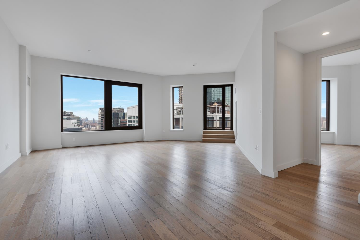 This spectacular 3 bedroom / 3 bathroom corner unit with alcove home office and 118 SQ FT private terrace offers walls of windows and unobstructed Northeastern views high above the New York skyline.  Featuring lofted ceilings, in-unit washer/dryer, double sink master bathroom vanity, enormous walk-in closets, Caeserstone kitchen countertops, Boffi lacquer kitchen cabinetry, appliances by Sub-Zero, Liebherr, Bosch, Miele, Electrolux and Sharp, your new kitchen is a chef's dream.  Bathroom features include Botticino semi classic marble flooring and wide plank cerused oak flooring throughout the apartment exemplify the top of the line finishes you can expect in this exquisite apartment.Additional concierge services include room service, catering, housekeeping, on-site parking and valet laundry.