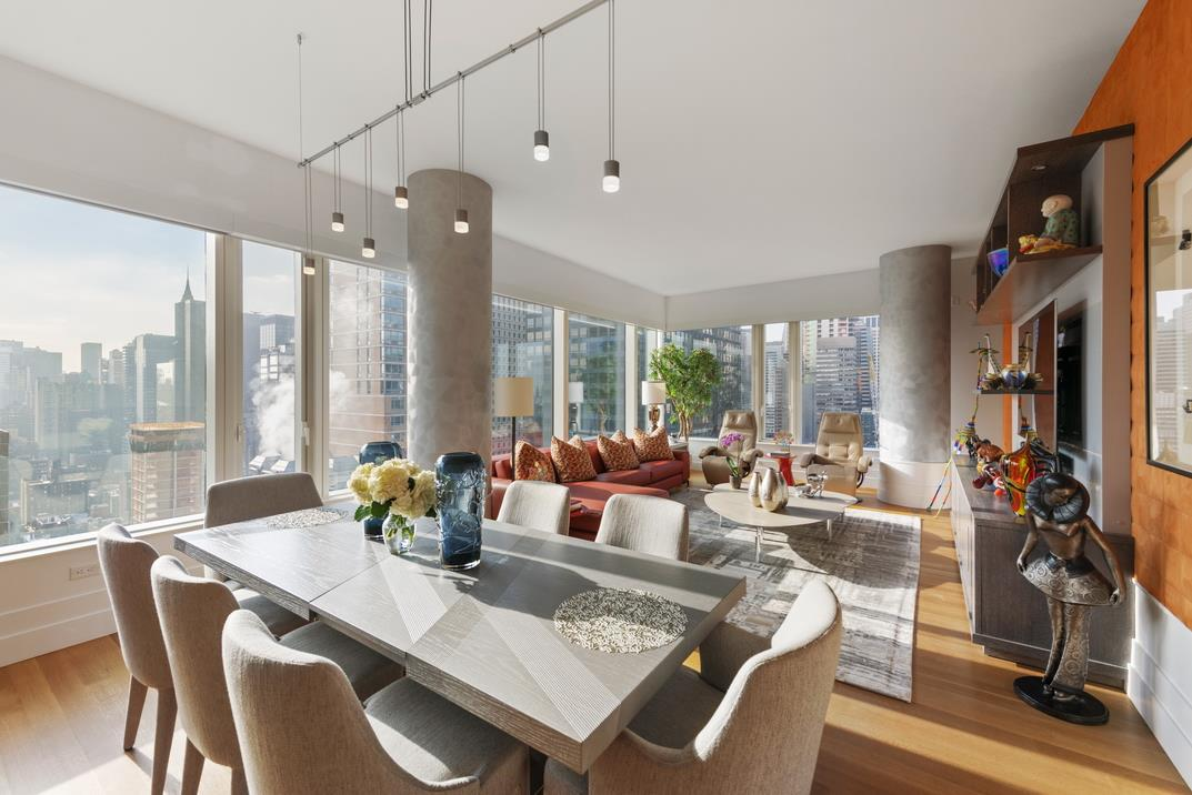 This is a rare opportunity to purchase the only 3 bedroom 3 bath apartment available at the spectacular sold out new luxury glass condo tower, 252 East 57th Street, designed by Skidmore, Owings & Merrill located on the world famous 57th Street corridor. As the building's first 3 bedroom resale, this new beautiful spacious 1,932 square foot home perched on the 36th floor features floor to ceiling glass windows with dramatic panoramic skyline views, pristine high-end finishes, and extraordinary building amenities. From its walls of windows and the building's unique stunning curved glass curtain wall, the views are equally spectacular of the skyline during the day and of the romantic city lights at night.A gracious foyer leads to a fabulous open entertaining space comprised of a 27 foot long corner living and dining room with airy 10 feet ceilings flooded with sunlight from its southern and western exposures. The open large kitchen features a spacious island that seats four, elegant HanStone white glass quartz countertops and backsplash, custom walnut cabinetry offering substantial storage, an oversized Kohler sink, and top of the line Miele appliances: vented five-burner gas cooktop, two ovens (with microwave & convection), wine refrigerator, and dishwasher.The substantial master suite provides dazzling views from the bedroom's massive window, his and her closets, and a breathtaking ensuite master bathroom with a massive window providing spectacular views day and night. The bathroom is elegantly appointed with polished white Nanoglass walls and floors, radiant heat floors, a walnut double sink vanity with a white Nanoglass top, a stunning custom 6 foot free-standing oval bathtub, a large glass enclosed shower with three shower heads, a glass enclosed Toto water closet, and Dornbracht and THG fixtures. The second and third bedrooms both feature dramatic curved windows with captivating views, custom closets, and ensuite bathrooms with pristine finishes.Additional featur