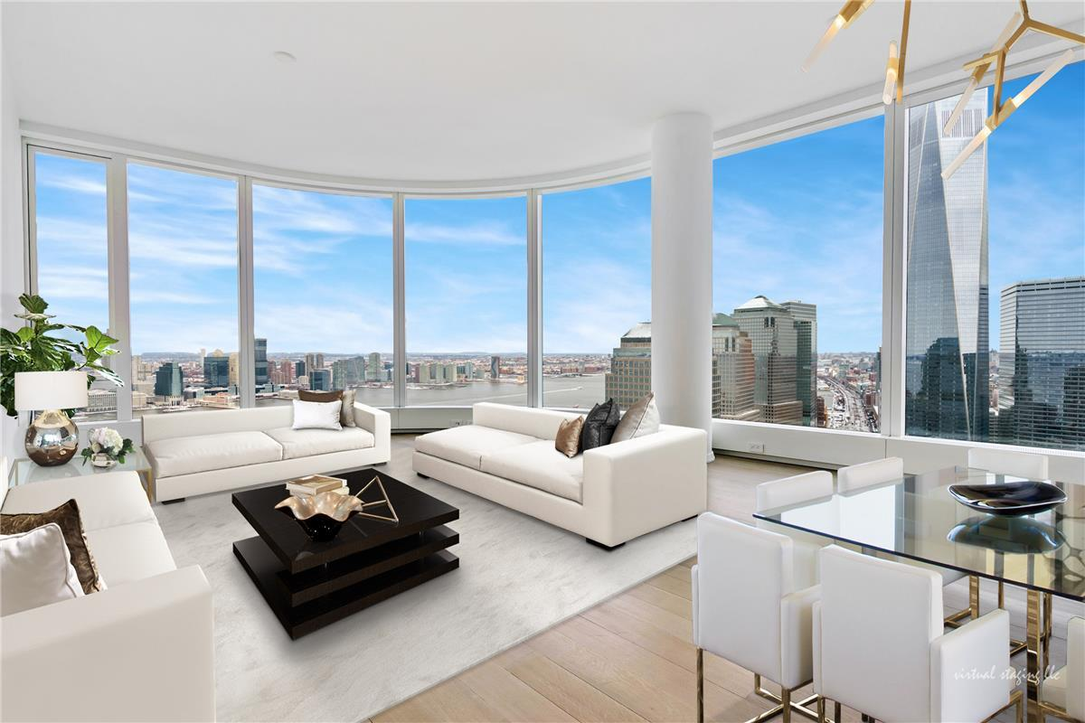 LIMITED TIME ONLY: OWNER PAYS 1 YEAR OF COMMON CHARGES AND TAXES !Rare Opportunity in 50 West - One Bedroom plus Home Office with Two Full Bathrooms! Enjoy Stunning Views from the 55th Floor in this Bright and Spacious Corner home. Curved, panoramic, floor to ceiling windows provide glittering views of the Hudson River and the NYC city skyline from this bright and airy residence. An elegant entry foyer leads to a Living room with dramatic views of One WTC and Hudson River. It has an open kitchen floor plan and is designed with Italian custom stained walnut cabinetry, brushed granite countertops, and a waterfall island. First-in-class appliances from Miele and Sub-Zero include: wall mounted oven and speed oven, gas cooktop, refrigerator, freezer, wine refrigerator, dishwasher and a range hood that vents directly to the outside. Bright Master Bedroom facing West, overlooking water and has Statue of Liberty view. The en-suite five fixture master bath features a floating backlit marble vanity with double sinks, a large stall shower with rain showerhead and separate dip soaking tub, Hansgrohe polished chrome fixtures, an electronic Toto toilet with built-in bidet and radiant floor heating. Second Bath has a shower and is finished with Travertine Stone. There are white oak wood floors, throughout the residence. This home also features a vented large sized washer and dryer, for all of your laundry needs.Truly a unique residence and place to be called home!Building features: 4 Floors of Amenities, including: Water Club with 60FT lap pool, Fitness floor, Entertainment floor and unique Observatory with 2 BBQ, located on 730 FT elevation overlooking NYC Harbor and endless water views.