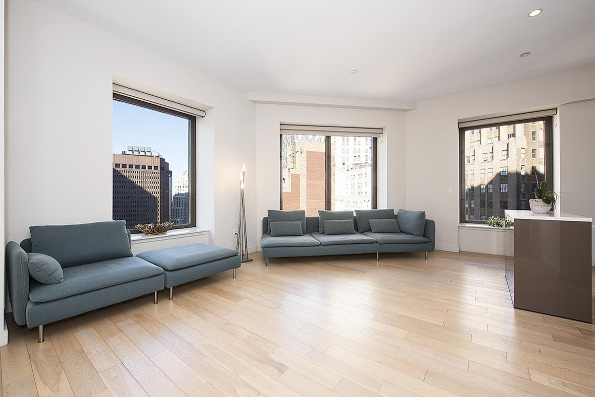 NO FEE!A spacious one and a half bedroom, two full bathroom apartment in a luxury building with all amenities, located in the heart of Financial District (Wall St.). This apartment is fully-equipped and outfitted for your perfect stay. Can be rented furnished or unfurnished. The building has a doorman, modern gym, two residential lounges, rooftop terrace with 360 degrees views of the city. Located on top on a 4.5-star hotel. All hotel amenities are available to the residents, such as spa, bars, restaurants. Less than 5 minutes walk to several subway stations. Staying at this apartment truly allows experiencing the spirit and luxury of New York. The spaceThe apartment is on the 29th floor with the beautiful views of the city and more than three times the size of a typical Manhattan apartment. 1,100 square feet, modernly decorated, a fully-equipped kitchen with stainless steel appliances, high ten-foot ceilings, oversized windows, in-residence washers and dryers, oak floors, marble bathroom, lots of light and open space. Residents can enjoy comfort and amenities usually associated with 5-star hotels.AmenitiesThe on-site fitness facility offers treadmills, various fitness equipment, yoga studio. Two residential indoor and outdoor lounges, rooftop terrace with amazing 360-degree views of the city, including such landmarks as Empire State Building and Chrysler building, harbor and downtown Brooklyn.24-hour Concierge Desk.The neighborhoodStay on the famous Wall Street, in the center of Financial District! Feel the city's life pulsating around when you go up Wall St., or go down towards the East River (one block from the building) to enjoy peace and serenity. This neighborhood is both historical and modern, where iconic skyscrapers co-exist with narrow, welcoming streets and easy transportation access. It is very close to all city's attractions and nightlife.  5 min walk to NY Stock Exchange, Wall St. famous bull, Pier 17, Ground Zero, 10 min walk to Statute of Liberty fer