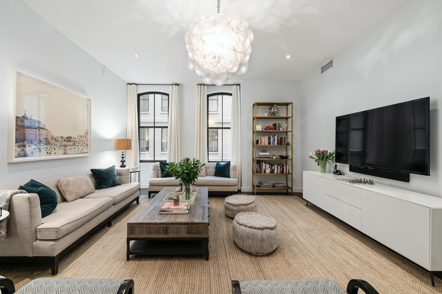 Don't miss this opportunity to live in one of Tribeca's most sought after pre-war conversions, 250 West Street! Move right in to this beautifully designed OVERSIZED 2 Bedroom 2.5 Bath plus large Den/Bedroom.  This gracious 1973 sq ft loft boasts 10 ft ceilings and 5-inch wide-plank oak flooring throughout. If cooking or eating is your thing, the well appointed open Chef's kitchen is set up for entertaining or just enjoying your loved ones. The kitchen is equipped with Poggenpohl cabinetry, an integrated Subzero refrigerator, wine fridge, and a Bosch stove, range and dishwasher. One highlight of this home includes something that cannot be designed or added to just any home.  A good nights sleep and a peaceful life requires QUIET.  3A will provide you with peace and quiet all day and all night. Retire to your serene Master suite which offers a well thought out walk-in closet and a luxurious en-suite Bath with a double sink, deep soaking tub and separate stall shower. The generously sized second Bedroom offers an en-suite Bath and an abundance of closet space. The third room is spacious enough for a Bedroom, Playroom or Home Office. Central air conditioning, a Bosch washer/dryer and a half bath for guests, complete this home.  In addition to the abundance of closets there is a 28 SF private storage bin included with the home. Enjoy being pampered and well taken care of in this full-service building with a wonderful live-in resident manager, full-time doorman and concierge.  Best amenity rich building in Tribeca, includes a walk-in refrigeration room, comfortable library/ lounge,  lap pool including men and women's locker rooms with saunas, state-of-the-art fitness center, children's playroom, 5,000 square foot roof terrace with stunning city views, sundeck, grill and dining area. Outside of your front door you will have access to the best restaurants, shopping, running, biking, tennis, basketball, skate boarding park and Hudson River Park's Piers 25 and 26 which offer 