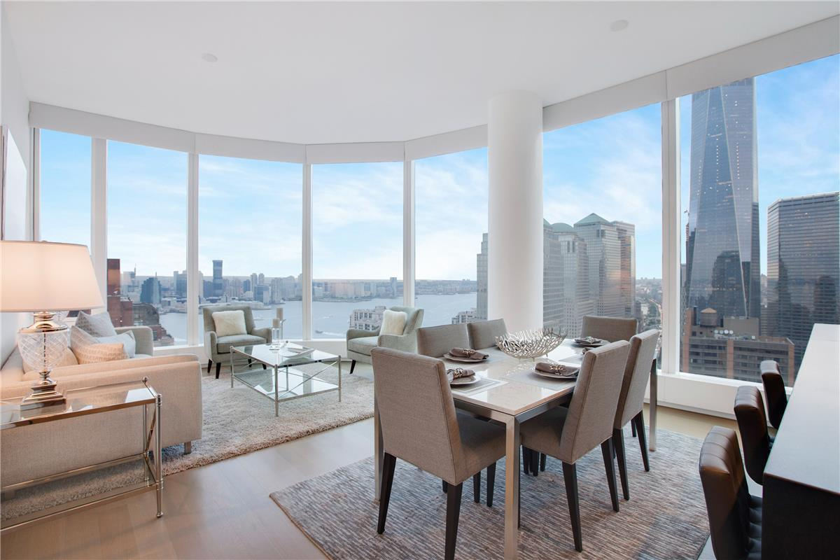 IMMEDIATE OCCUPANCY! NO BROKER FEE!Fully furnished one bedroom, two bath corner home with huge windowed Walk-in closet makes this home a rare opportunity. Floor-to-ceiling windows in the open living, dining and kitchen space provide glittering views of the Hudson River and the NYC skyline.Entry through the inviting foyer leads to an elegantly designed living and dining room, focusing your attention on the magnificent view of One WTC. The kitchen boasts beautiful Italian walnut cabinetry, granite countertops, and a waterfall island, along with all the glassware, utensils, and cooking equipment you will need. First-class appliances from Miele and Sub-Zero include wall-mounted ovens, gas cooktop, refrigerator, range hood, wine refrigerator, and dishwasher. Bright and comfortable, west-facing master bedroom overlooks the water and has Statue of Liberty views. The en-suite master bath features a marble vanity with double sinks, a large stall shower with rain showerhead, separate deep soaking tub, heated flooring, and Toto toilet. Home office includes a desk, television, and pullout couch with a comfortable feel. The second full bathroom is tastefully finished with Travertine stone. White oak wood floors throughout the home keep it light and airy. Laundry will be a breeze with the large washer and dryer. Wireless internet and basic cable included in rent.Leasing available from 6 months to 2 years makes this home unique and move-in ready!
