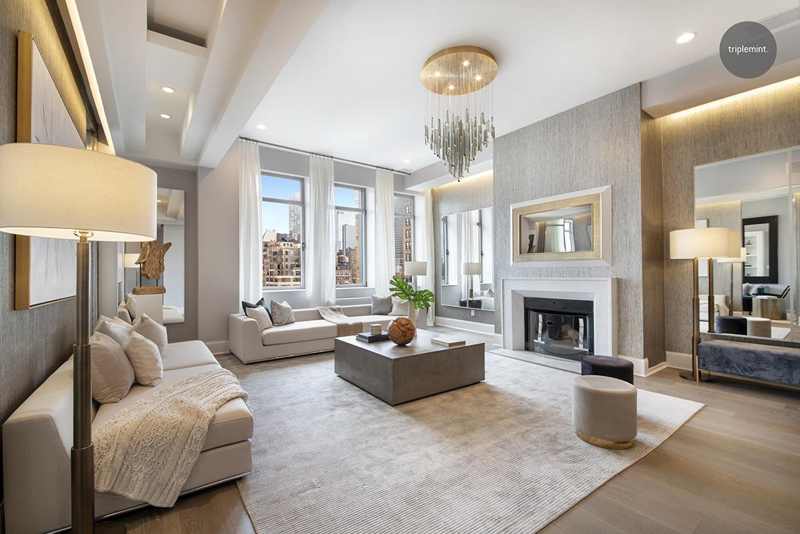 Penthouse perfection at the freshly remodeled Chelsea Mercantile.PHJ is brand new to the market, and one of the most jaw-dropping two bedrooms to hit the market in the last several years. Renovated and designed to absolute perfection, this home is not to be missed.Upon entering the home, the grand scale of the living room is the first thing you will notice. The ceiling height soars to 12 ft, and the entire room is drenched in natural light from the three north facing windows. The room has been upgraded with brand new beautiful hardwood floors, custom lighting features, a working fireplace, and unobstructed views of the Manhattan skyline.The kitchen was fully remodeled just over a year ago. With custom cabinetry, marble counters, miele, wolfe, and subzero appliances, no expense was spared in this thoughtful upgrade. Additionally, the kitchen features a beautiful banquet, wine fridge, and a custom wine and bar cabinet to make entertaining a breeze.The bedrooms at Chelsea Mercantile are notoriously gigantic, and the rooms in PHJ will not disappoint. The secondary bedroom is larger than most masters, and the king-size master suite has custom built-ins, a large walk-in closet, and a 5 fixture master bathroom.With one of the most incredible lobby renovations freshly complete, the Chelsea Mercantile is one of the most impressive condominiums in Chelsea. It features the conveniences of a full-time doorman, gym, children's playroom, storage, and a beautiful roof deck with 360-degree views of Manhattan and all of its iconic buildings.Call today to schedule your viewing!