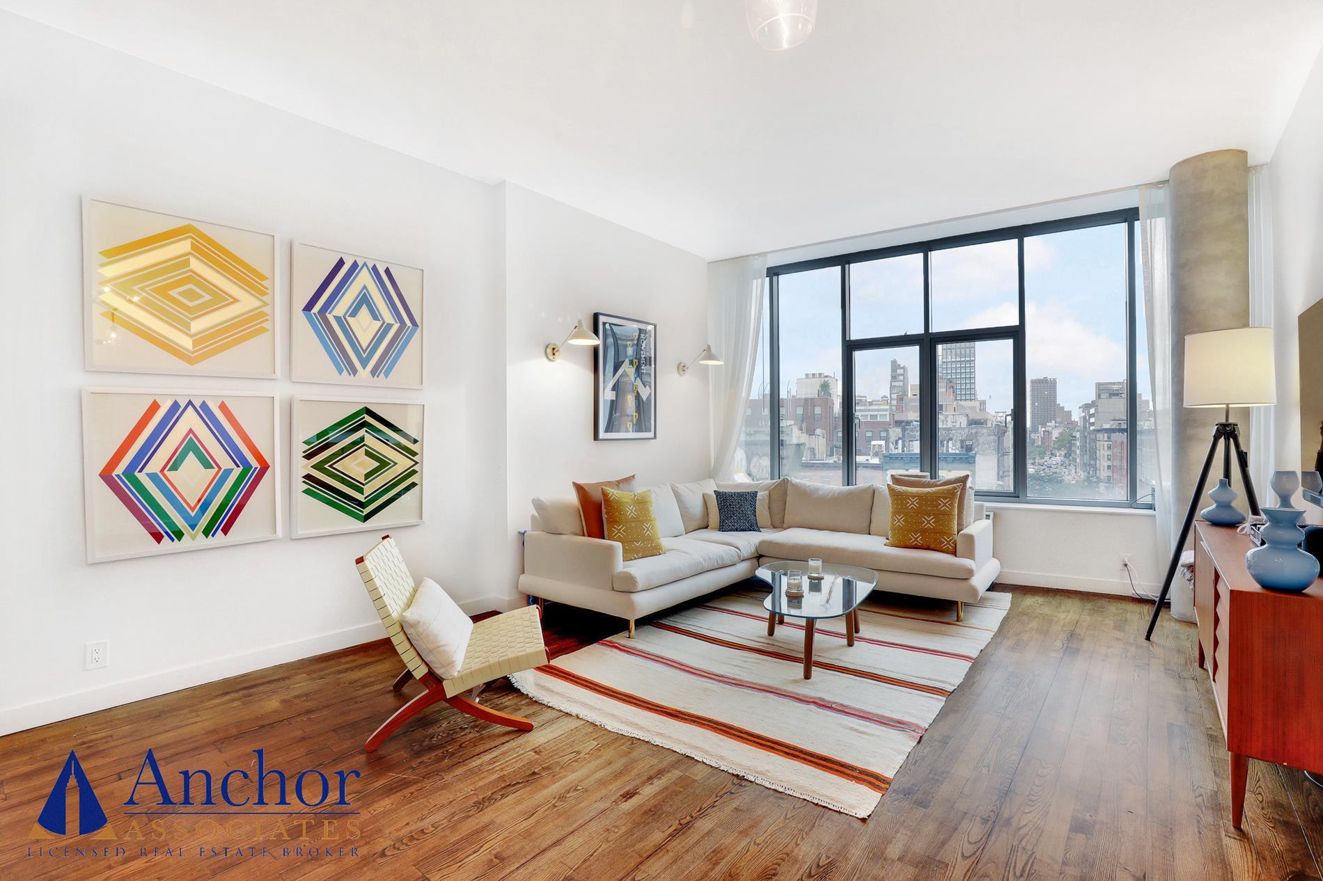 """Open the door to your dream apartment, right in the heart of New York City's most desired neighborhoods... Enter a large, marvelous open space with 10' high ceilings and oversized windows, revealing breathtaking urban views! The living room also features beautiful genuine hardwood floors and incredible living space to relax and entertain. The State-Of-The-Art open kitchen will make your cooking experience super convenient with it's extra large Carrara Marble countertop, top-of-the-line stainless steel appliances, white cabinets with expensive gold handles and a custom door panel ready dishwasher! On the other side of the apartment you will find the incredible master bedroom, featuring great space, wonderful natural light, """"his & hers"""" build-in closets and a stunning En-Suite bathroom with a double vanity, a bathtub+shower and expensive modern fixtures. Right by it you'll find the second bedroom, also featuring a great amount of space, as well as great natural light and a built-in closet. To make your living situation more comfortable, you'll enjoy a guest full bath with modern fixtures and a tub, and an in-unit washer/dryer!This remarkable unit is located on the 6th floor of a luxury doorman building. Enjoy entering a beautiful lobby with a concierge, as well as classy elevators and an on-site health club!**AREA** PRIME SOHO LOCATION! This building puts you right in the beating heart of NYC, surrounded by the best restaurants, cafes, bars and boutique shopping. Enjoy everything that this city has to offer, all within walking distance! *Petrosino Square*By CHLOE*Club Monaco*Indochino*Marc Jacobs*Balthazar Restaurant*MOMA Design Store*Alo Yoga*Beyond Sushi*The Grey Dog*Amici ll*Prologue Coffee Room*The Mercer Kitchen*Sakura **Micheline Star Restaurants** Hiroshima*ZZ's Clam Bar*Uncle Boons*Contra*The Musket Room **Transportation** B/D/F/M/6/N/R/W Subway Lines!"""