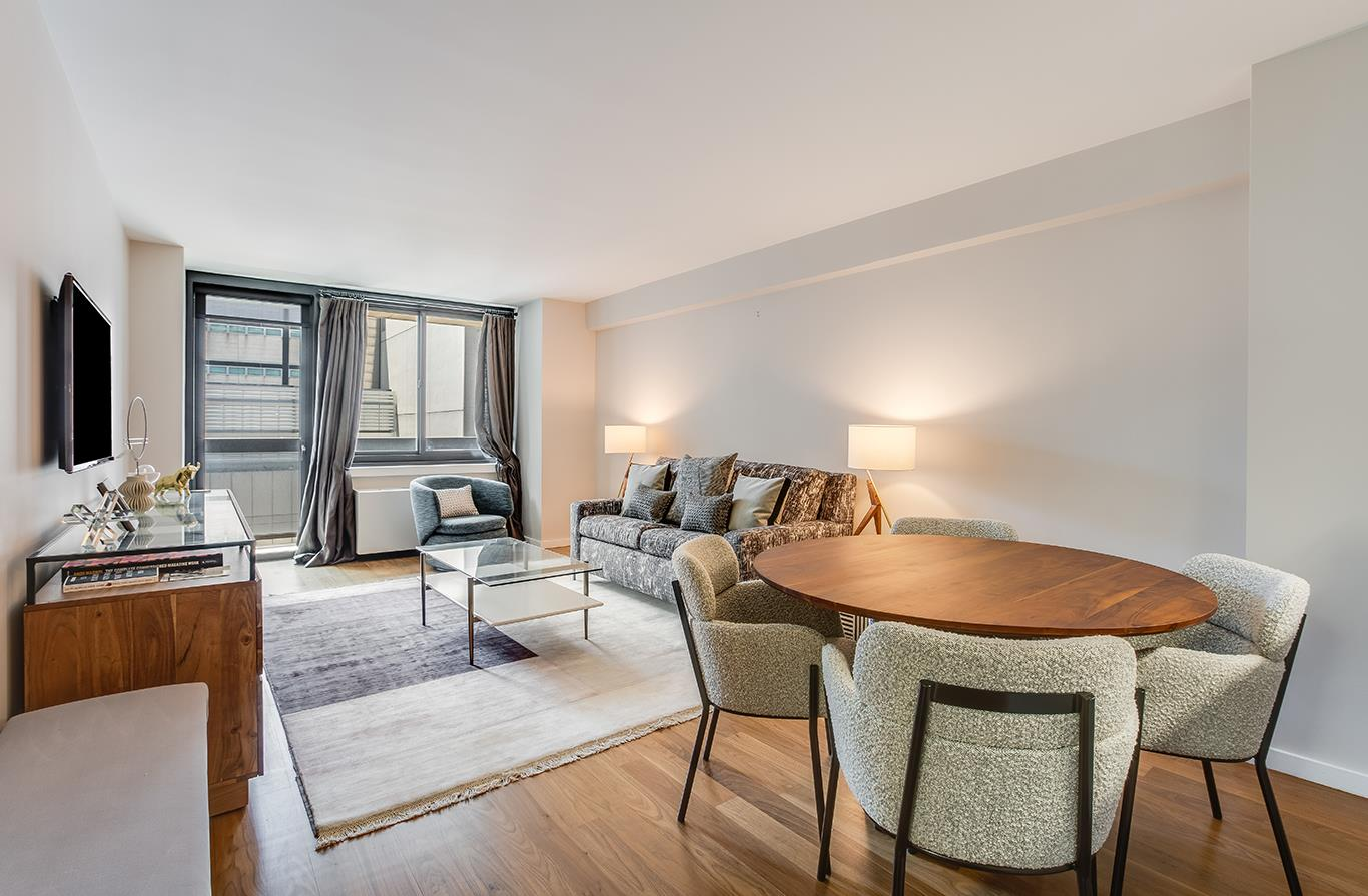 A luminous condo tucked away in a tranquil residential enclave of Lenox Hill, this 1-bedroom, 1-bathroom home is the quintessence of contemporary city living. Features of this 687 sq. ft. apartment include beautiful walnut hardwood floors, oversized windows with southern exposure, a convenient in-unit washer/dryer from Bosch, and a lovely 13-ft long balcony ideal for lounging and entertaining.Beyond a functional entryway adorned with a coat closet, the home flows into a 20-ft long living and dining room saturated with natural light. The living area leads out onto the balcony, while the dining area is adjacent to a semi-open galley-style kitchen equipped with an eat-in bar, custom walnut cabinetry, sleek Corian countertops, a Basaltina lava stone backsplash, and a suite of high-end stainless steel appliances from Liebherr, Thermador, and Miele. The bedroom has a large reach-in closet and easy access to a pristine full bathroom with custom tiled walls and floors, chic Watermark fixtures, and a Zuma soaking tub. 515 East 72nd Street is a luxury condominium nestled on an exclusive cul-de-sac street in Lenox Hill. The building offers residents a host of world-class amenities that include a private half-acre park, a full-service spa, a state-of-the-art fitness center, a 56-ft indoor pool, fitness and wellness programs, indoor basketball, squash, and racquetball courts, a rock climbing wall, an art studio, a children's playroom, and an attached parking garage. Additionally, the building has a 24-hour doorman, concierge and porter staff, maid service, a live-in super, and private storage. There are many restaurants, cafes, bars, and shops nearby, and the N/Q subway lines are just two blocks away. Pets are welcome.