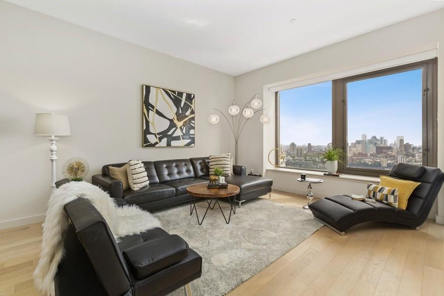 Spacious and sun-flooded LOFT style apartment in the Financial District with breathtaking views of the skyline and the river! An out of this world opportunity in the center of NYC's financial district. 75 Wall Street is where world-class buildings rise into the clouds and the sky's the limit! Let me bring you inside unit 36R  where you can live, work and entertain inside this luxury loft-style apartment spacious convertible 1 bedroom. With  938 sqft of space, this home is the quintessential meaning of modern city living.Barely lived in, from top to bottom this space features light oak hardwood floors, 11 Foot ceilings providing a spacious feel. The open chef's kitchen boasts a sizable CasesarStone countertop, lacquered cabinetry by the Italian Design Studio, and premium appliances by SubZero, Liebherr, Bosch, Miele, Electrolux, and Sharp. This spectacular apartment offers stunning views of Brooklyn and the East River, an in-unit washer/dryer, duo vanity bathroom in addition to a powder room with marble flooring. The details exemplify the top of the line finishes you can expect in this exquisite apartment.Living at 75 Wall Street defines world-class luxury with a full-service lifestyle with an abundance of amenities like a hotel-style concierge, 24-hour doorman, gym, lounge with billiards and a children's playroom, rooftop terrace with indoor and outdoor lounge, and extraordinary views of NYC.Here you'll have everything you need at your fingertips for a One of a kind luxury living experience in downtown manhattan. Enjoy approximately 5-8 minute distance to the subway and many desirable locations including South Street Seaport, Brookfield Place, Stone Street for great restaurants, and the world know Wall Street Bull.