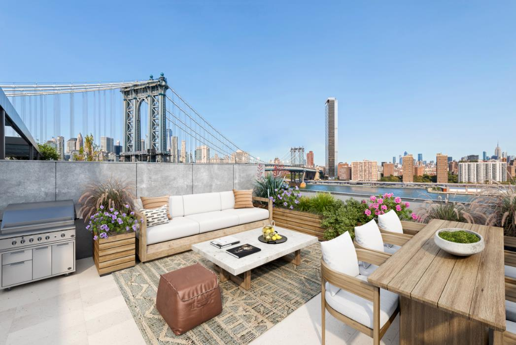 This Penthouse is the Crown Jewel of DUMBO. Located within one of the most iconic buildings in the neighborhood, 1 John is a multi-award winning boutique condominium located in the heart of DUMBO, right along the water's edge.This majestic 4 bedroom Penthouse is in MINT condition and enjoys endless NYC Skyline, East River and Bridge Views throughout. The home spans 2,539sf and has a private roof terrace and courtyard  over 700sf of private outdoor space! Parking & Private Storage Available. Upon entering the home through the gracious entry foyer, you will be captivated by the 22 oversized windows that enjoy all four exposures and flood the home with natural light and jaw-dropping views of all of Manhattans most iconic buildings including the Empire State Building, Chrysler Building, 1 World Trade Center and more!This is home redefines luxury living. The 33' open-concept corner living room is planked by a ventless eco-fireplace and sliding nano glass door that completely opens to a glass-enclosed courtyard which offers the ultimate indoor-outdoor living experience.The open-chefs kitchen features a Basaltina stone counter, a wall of integrated full height Italian cabinetry by RiFRA with Gaggenau appliances, a Bosch dishwasher, vented ceiling hood and wine fridge.Away from the entertaining space and along the corridor of the home, each of the king-sized bedrooms features tremendous custom closets and oversized windows. The corner master suite, enjoys spectacular sunrises through the Eastern exposure and has a phenomenal walk-in closet expertly designed by California Closets and a spacious windowed bathroom with Dornbracht Fantini fixtures, an oversized double vanity, double shower heads and upgraded tile by Mutina.Travel up the courtyard stairs to your private roof deck complete with a gas grill and breathtaking views of the entire Manhattan skyline and close enough to the water's edge that you can feel the crisp breeze from the River and the waves crashing along the b