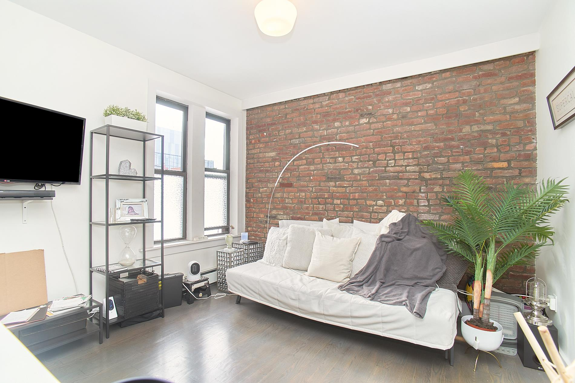 BACK ON THE MARKET! LAST DEAL FELL THROUGH!Welcome to Saint Ann's Court located in Central Harlem! A charming pre-war building with modern finishes and amenities. This unit also includes an additional storage space in the building.5K is a 455 sq-ft 1 bedroom filled with tons of natural sunlight. The living area features an open kitchen with stainless steel appliances, brick exposure & generous space for comfortable living. The bedroom comfortably fits a queen sized bed with furniture. You'll find 3 large closets with the perfect amount of storage space for the unit. A modern bathroom with a rainfall showerhead.Saint Ann's Court is a beautifully renovated condo conversion with elevator & laundry in the building. The building features a gym, bike room and a beautiful shared courtyard.