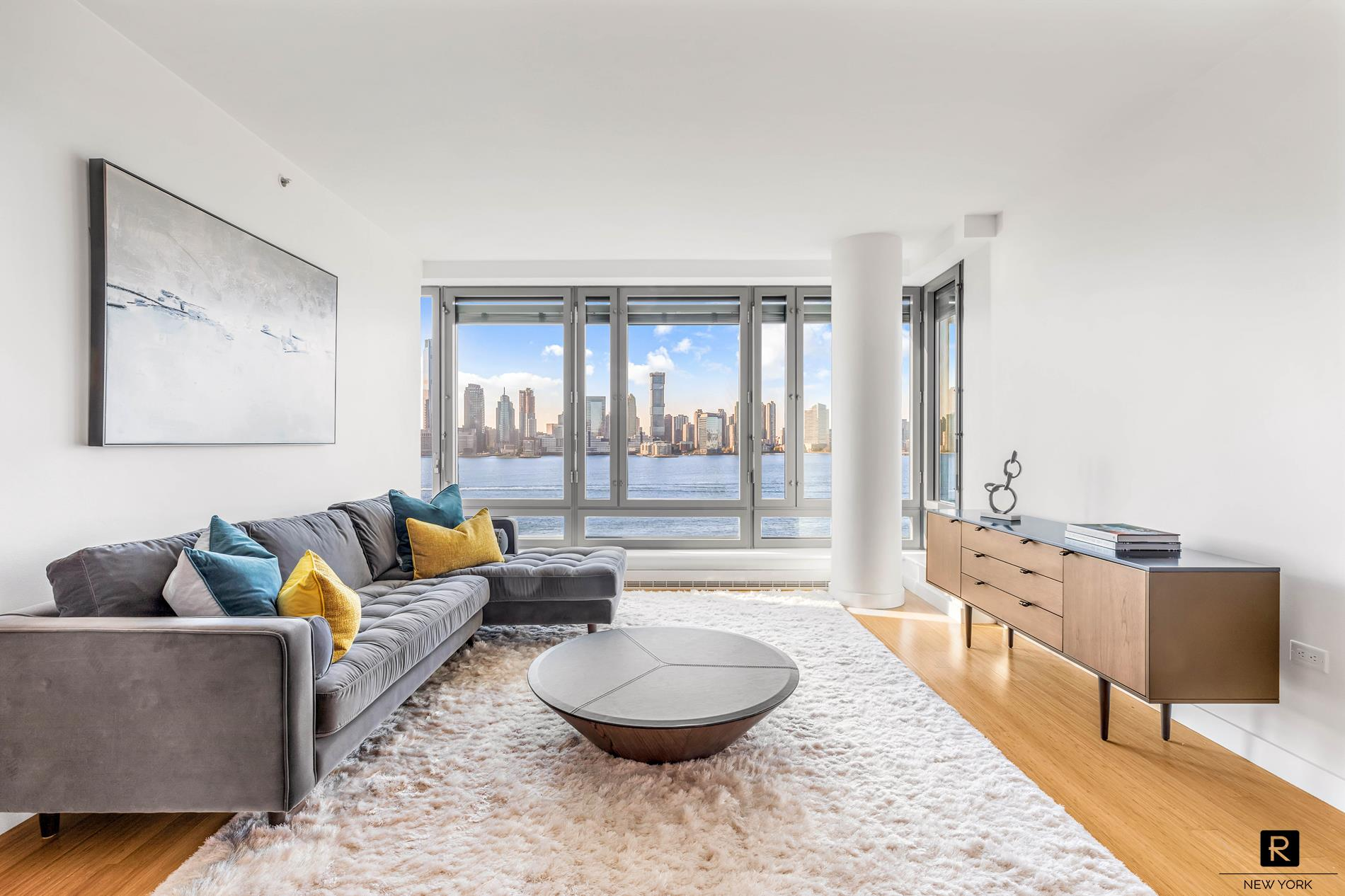 """WATERFRONT LIVING AT IT'S BEST! -- 3 bed/3.5 bath plus home office with direct Hudson River views in the Riverhouse, the only LEED Certified Green condominium in North Battery Park / West Tribeca.  This highly sought after, rarely available """"J"""" line encompasses almost 1,900sqft and has a loft-like feel with it's tall ceilings, wall to wall windows, large open living/dining area and spacious kitchen. Relax and marvel at the breathtaking views from your living room of the Hudson River, Statue of Liberty and Rockefeller Park.  Chefs will love this 14' wide kitchen featuring custom Italian teak-faced cabinetry by Schiffini, Corian countertops, large island, wine refrigerator and energy star appliances by Sub-Zero, Thermadore and Miele. All three bedrooms and office are split from each other allowing for maximum privacy. The master bedroom has complete privacy with it's West facing windows looking out of the parks and water, two large closets and an en-suite bathroom with double sink vanity, frameless glass shower, separate Neptune soaking tub and honed-finished travertine marble. There are two additional well-proportioned bedrooms each with en-suite bathrooms and a separate heated/cooled home office area with custom fitted cabinetry.  A powder room, fitted closets, multi-zone thermostat controls, filtered air and water and a Bosch washer and dryer complete this home. *** THERE HAS NOT BEEN A """"J"""" LINE THAT HAS COME AVAILABLE FOR SALE IN ALMOST 10 YEARS.  SOUGHT AFTER FOR IT'S EFFICIENT LAYOUT AND VIEWS ***The Riverhouse is situated in front of Rockefeller Park greenery and the Hudson River. This full-service building is rated Gold by the Leadership in Energy and Environmental Design (LEED) program. This luxury condominium features 24-hour concierge service, on-site parking garage, 50' lap pool, fitness center, bicycle storage, billiards area, landscaped interior courtyard and outdoor terrace, media cafe, and private pet grooming area. The building is home to the Poets Ho"""