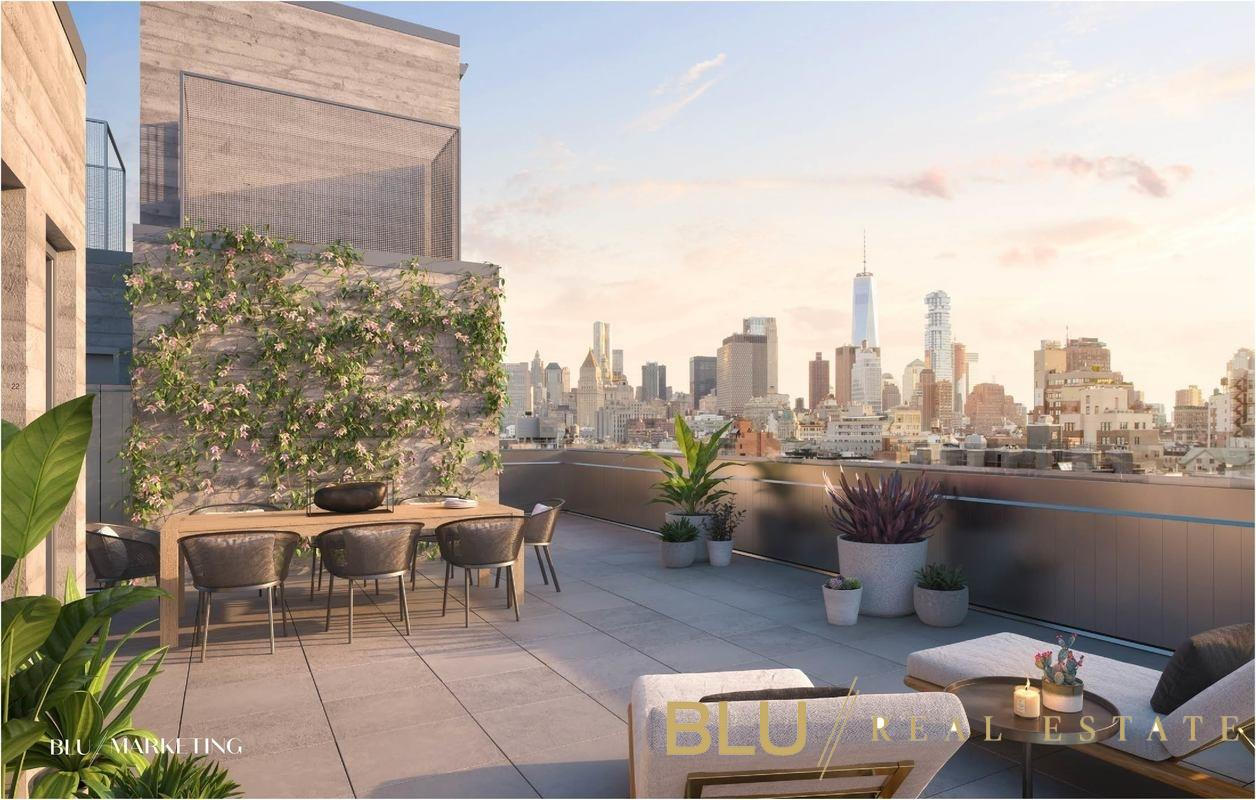 """Designed by Morris Adjmi Architects, 260 Bowery is an art piece, limited to just 5 residences. Each home features its own outdoor space and generous room for entertaining. Designed to the tune of 'living spaces, not sleeping spaces', the building is swathed in beautiful architectural masonry in concert with the creative spirit of the neighborhood and offers unique sanctuaries above the hustle and bustle that is Manhattan. The PH of this limited-edition condominium offering is an entertainer's dream, with over 1,000sqft of balconies and terrace spread over three levels and a rooftop outdoor kitchen, the opportunities for alfresco meals and gatherings under the stars are boundless. The keyed elevator opens to an expansive 4,150 square foot four bedrooms, four bathrooms home, with a generous living room, and additional dining, library, and media rooms. The expansive European Aluprof windows with UV protection and sound proofing enhance the tranquility of this duplex floor through home. Stunning 11"""" wide European white oak floors accentuate the custom designed aluminum clad kitchens that feature honed quartzite countertops and backsplash, oversized fireclay sinks with Dornbracht fixtures, and a top-of-the-line Gaggenau and PITT Cooking appliance package. The master suite is a quiet sanctuary with a massive walk-in closet and additional access to the balcony via floor to ceiling glass doors that flood the space with light. The master bath is finished with large format honed silver shadow blue marble, custom prime European white oak cabinetry with Calacatta marble countertops and Dornbracht fixtures throughout. A glass enclosed wet room offers a steam shower with a Calacatta marble shower bench and separate soaking tub. Secondary bathrooms offer large format concrete tiled floors, and Calacatta Prima marble tiled walls, vanities, and tubs. 260 Bowery is situated in the Bowery Historic District, where four of the oldest and most authentic downtown neighborhoods meet. In a """