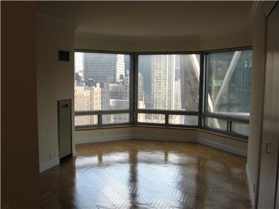 Stunning South (SE, South and SW) view of the Manhattan skyline from massive bay window are what strikes you when you enter this spacious studio home! Overlooking 57th Street (a.k.a Billionaires Row) and the Hudson River.The Central Park Place Condominium is a luxury building with 24-hour doorman, concierge, live-in superintendent, fitness center, indoor pool, outdoor terrace with Central Park views, and a resident lounge. Perfectly located next to Central Park and Columbus Circle, Time Warner Center, and all that Midtown has to offer with multiple transportation lines, world-renowned restaurants, and shopping. Conveniently located right by the new Turnstyle underground market. Central Park Place Condominium features four private hotel-style suites that can be reserved for nightly use by residents' guests, a large fitness center with towel service, indoor swimming pool, sundeck and resident's lounge with a full catering kitchen and free wi-fi.Central Park Place Condominium is easily accessible to the A, C, B, D, 1, Q, N, R subway lines and the 57th Street Cross town bus service.Condo board application required - No pets allowed.