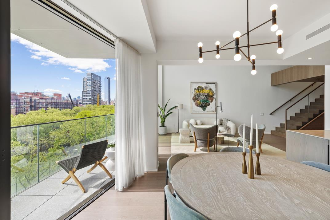 IMMINENT OCCUPANCYA luxurious floor-through condo crafted by renowned designer, Thomas Juul-Hansen, this bespoke 2,405 sq. ft. duplex 3-bedroom, 3.5-bathroom condo blends a curated collection of organic elements to enhance timeless layouts that maximize space and natural light.Features include a double height 18'3' ceiling, designer-selected European wide-plank oak floors, oversized double-pane windows with eastern and western exposure, a laundry room with a utility sink and an externally-vented Whirlpool washer/dryer, energy-efficient multi-zone heating and cooling, Rift Sawn oak closets, a 91 sq. ft. private balcony, and unobstructed views of Sara D. Roosevelt Park.Beyond a tasteful entryway adorned with an immaculate powder room, the lower level of the home flows into a bright, open-concept living room, dining room, and kitchen. The kitchen is equipped with an eat-in island, desert quartzite countertops, a matching backsplash, custom rift sawn dark-stained oak cabinets with tempered bronze glass, Dornbracht fixtures, and a suite of high-end fully-integrated appliances from Miele and Sub-Zero.The master bedroom boasts a massive walk-in closet, additional reach-in closets, a private balcony, and a sublime en-suite bathroom with chamber-fumed hardwood floors, a bronze-tinted medicine cabinet with cove lighting, double vanity, an enclosed remote-controlled Toto toilet, and a honed marble wet room with a walk-in rain shower and a deep soaking tub.The upper level of the home possesses an open mezzanine, the laundry room, and a pair of bedrooms with private closets and full en-suite bathrooms.A collection of interlocking villas designed by Thomas Juul-Hansen, 199 Chrystie is a luxury condominium that sits at the nexus of an incredibly dynamic, multi-neighborhood location. It is surrounded by endless retail, social, and food and drink options, and has easy access to the Lower East Side, NoLita, NoHo, SoHo, and the East Village. It is around the corner from Whole Foods, a