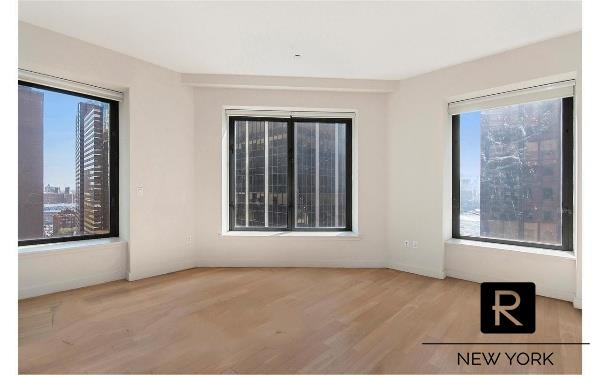 """This 2 bedroom, 2 bath corner apartment features Lofty 10'+ ceilings with enormous 6'x 9' windows spreading exceptional light across every room with fantastic city & river views.The unit features wide planked oak flooring, central AC/heat, generous closet storage throughout, washer/dryer inside the apartment with an additional laundry room located in sub cellar. The open plan kitchen is imported from Italy by Boffi with a glass-tiled backsplash, caesarstone countertops, Italian lacquered cabinetry, double oven, 6 burner cook top, 36"""" Subzero fridge and a Miele dishwasher. The marble-clad bathrooms have vanities made of thick slabs of granite plus the master bathroom additionally features double sinks, a deep soaking bathtub and a separate Carrera marble rainwater shower.75 Wall Street is a World-Class Residential Luxury condo that sits atop the Andaz Hotel featuring 24-hour concierge and doorman, housekeeping & valet laundry services, refrigerated storage for grocery deliveries, bicycle storage, a state-of-the-art fitness center, billiards room, cinema room and a 360-degree indoor/outdoor rooftop deck with fully equipped kitchen, bar, grill, fireplace and Sky lounge. Exceptional convenience with easy access to all major transportation lines, taxis at your doorstep, grocery stores, restaurants, parks, waterfront access, etc."""