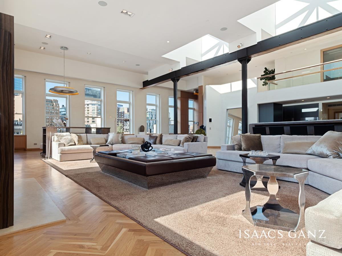 A rare opportunity to own one of downtown Manhattan's largest loft penthouses.  The Piero Manara & Debla Manara-Berger, of Casamanara, designed apartment offers an expansive 7,500 sq ft interior with a gracious 4,200 sq ft of unique covered and uncovered outdoor terrace space and sweeping 360 degree views. The boutique building of just 9 units allows for the utmost in privacy with a discreet elevator that opens to an impressive wood-paneled entry leading to a spectacular 65  40 foot living room featuring up-lit original cast-iron columns and ceilings that soar from 16' to 22' under light-infusing skylights. Massive windows facing south and west add even more light to shine through, creating the perfect space to entertain with views of the Freedom Tower perfectly framed. A nearly 6-foot-high wood-burning fireplace is finished with polished Eramosa marble and a honed Cohare marble hearth. The Bulthaup kitchen in grey aluminum features Carrara marble counters, a custom-built marble sink and is expertly equipped with Gaggenau, Sub Zero and Miele appliances including built-in coffee maker, instant-hot and filtered water and a large pantry.  White oak hardwood floors throughout lead you to a spacious master suite, along the way pass by venetian plaster finished walls in a soft white. The luxurious Master Suite offers silk carpeting and a beautifully outfitted white oak, custom-milled walk-in closet and vault that keeps everything neatly tucked away. The ensuite bathroom features a soaring octagonal skylight that hovers over book-matched Gaudi slab marble floors, a freestanding Oceanus soaking tub by Tyrell & Laing and a white Onyx lined double shower 'room' with rain-head shower. The three additional bedroom suites are generously sized, all with ensuite bathrooms and an impressive amount of closet space.  Not to be forgotten is the Dolby 10.1 surround sound Media room unlike any other, outfitted with plush upholstered stadium seating, dramatic cove lighting and ultra-sued