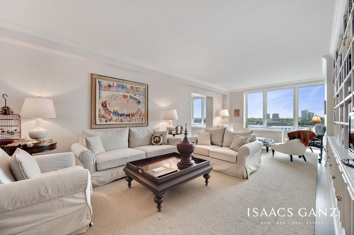 This grand, elegant 3-bedroom residence in The Rushmore is perfect for anyone who wants the stately layout of a prewar apartment combined with the luxury, space and amenities of a full-service condo building. This 2,173 square foot home has it all  a perfect layout with three formal foyers, breathtaking Hudson River and city views, and refined style and finishes throughout all rooms.The enormous living room features large picture windows that frame an incredible river view, showcasing boats passing by and beautiful sunsets over the water. Custom moldings and extensive bookshelves, paneling, and storage cabinets were commissioned by a leading woodworker who is also commissioned by some of NYC's top museums.The large kitchen is perfect for anyone who loves to cook and features ample storage and counter space, cookbook shelves, and Viking, SubZero and Miele appliances.The formal dining room with river views is perfectly proportioned and can be accessed from the kitchen or living room.All three bedrooms are private, totally quiet, and accessed via secondary foyer hallways. The enormous master bedroom has city and treetop views, incredible morning sun, a large walk-in closet, and a luxurious master bathroom with Waterworks fixtures, double sinks, and a separate bath and shower.The second bedroom also has city views and an en suite marble tiled bathroom with Waterworks fixtures.The third bedroom has lovely river views and is next to a hallway bathroom. Finishing touches throughout the apartment include crown moldings, select door hardware, custom millwork HVAC enclosures, and luxury wool carpets from ABC Home.This very special residence will appeal to discerning homebuyers seeking luxury, service, a perfect layout, and spectacular views.The Rushmore is a 291-unit luxury condominium on Riverside Boulevard. Located a few blocks from Lincoln Center and Columbus Circle, this exclusive residential building offers full-service amenities including doormen, a swimming pool, a chi