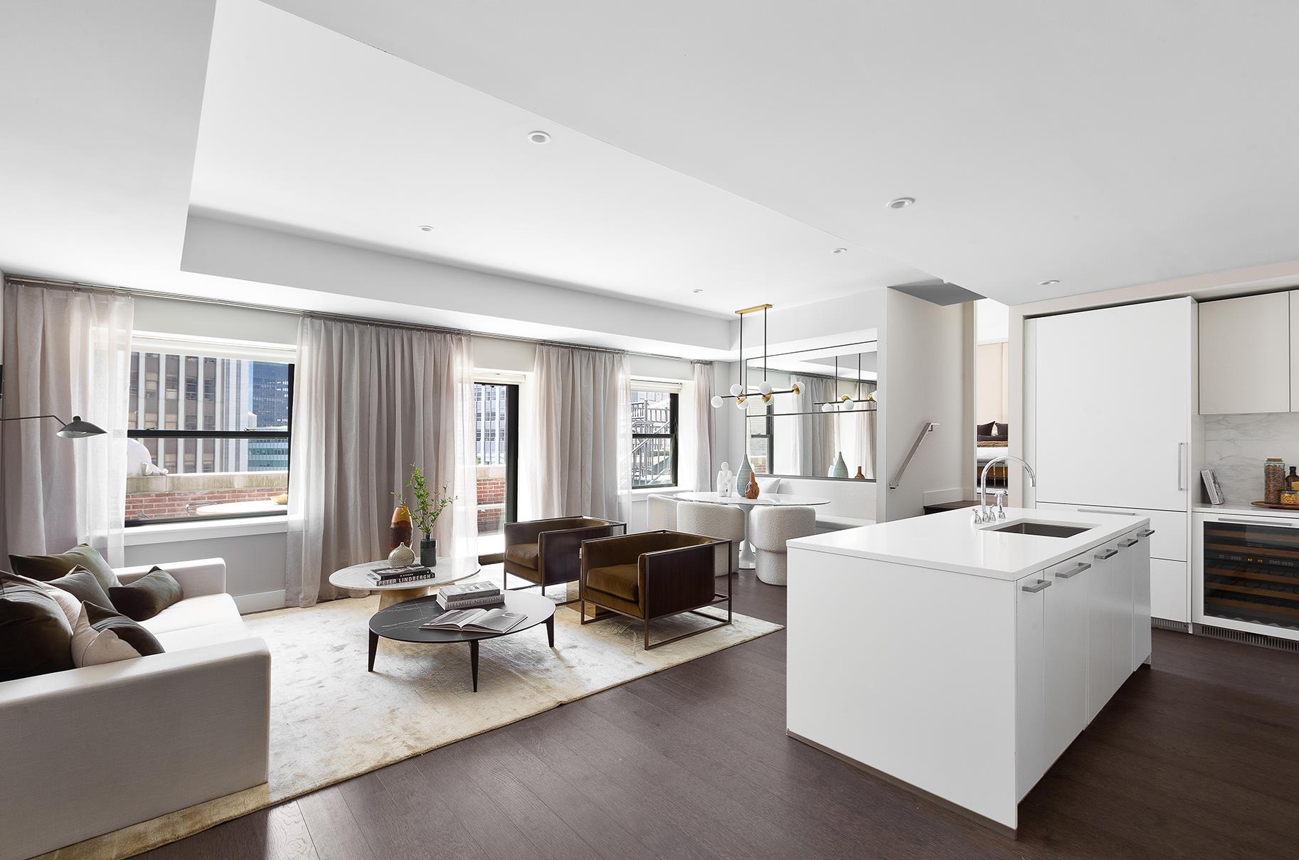 Welcome to the Financial District landmark, The Broad Exchange Building. This light-filled one-bedroom, one-and-a-half-bathroom penthouse is one of four exclusive penthouses at The Broad Exchange Building, measuring 1,132 square feet of interior space, and a private terrace measuring 410 square feet overlooking south of Downtown Manhattan. The outdoor terrace is accessible by two oversized glass doors from the living room and the primary bedroom, providing brilliant southern light exposures throughout.And to top it off, a real New Yorker's treat; a few steps away from major subway lines, including 1/2/3/4/5/A/C/E/J/M/R.The Penthouse Collection at the Broad Exchange Building redefines luxury living at the pinnacle of a beloved Manhattan landmark. Combining state-of-the-art modern finishes with timeless and classical sensibility, these premier homes embody the highest standard of living and are available at price points that offer extraordinary value. With oversized private outdoor terraces, the Penthouse Collection represents some of the most enviable settings in all of Manhattan.Overstated Private TerracesTucked away in the crown of this turn-of-the-century landmark, The Penthouse Collection offers one of the most coveted perks: private outdoor spaces ranging from 410 to 2,839 SF. Unwind in your own secluded sanctuary overlooking the breathtaking skyline and escape the world in the absolute privacy of your home in the sky.The Reawakening of the Most Storied Neighborhood in ManhattanCompleted in 1902, The Broad Exchange was once Manhattan's largest office building. Today, it offers residents an unparalleled opportunity to live in a setting that embraces the intersection of iconic and contemporary - quintessential landmark living in the heart of downtown Manhattan. Start your story where New York began its very own.The Everyday Luxury of Life at The Broad Exchange BuildingThe Broad Exchange Building provides an extraordinary collection of amenity spaces to enhance our