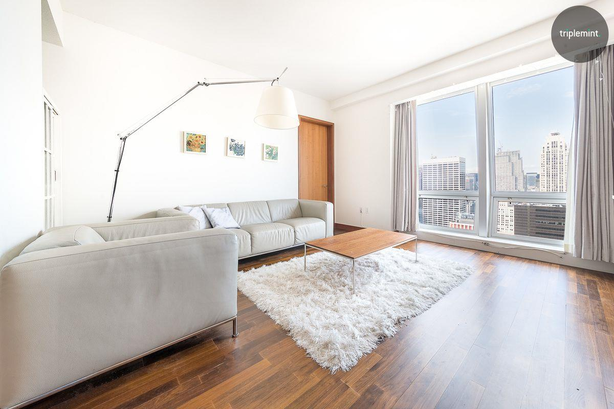 Welcome to The Residences On Fifth. Living here you have hotel amenities like maid service, room service, and a full-service spa. Situated on the 49th floor above the five-star Langham Place Hotel is this double corner 2 bedroom with 2 en-suite bathrooms. The appointed bathroom features include an ultra-luxurious Zuma soaking tub, custom rainfall glass shower, dual vanities, Grohe fixtures, marble floors, and walls. A Powder Room, washer and dryer in-unit, and great closet space by the entrance. Apartment #49E has exceptional city and river views with arched floor-to-ceiling windows throughout the apartment. The sun-drenched 1,437 SQFT space has two wonderful split bedrooms, a cooks dream kitchen with Mont Blanc stone countertops, Miele appliances including dishwasher, gas cooktop and oven, microwave, and Sub-Zero refrigerator. Unobstructed and continuous East, North to West Exposures with direct views of the Chrysler building makes this home a wonderful place to live. This home is currently tenant-occupied till November of 2022 with the current tenant paying $9,300.