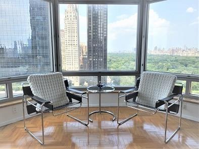 Views of Central Park, the Hudson River, and spectacular sunsets are all yours to enjoy!The Apartment:Prime corner, double exposure, fully FURNISHED 1 bedroom, 1 bath home perched on the 22nd floor, with mesmerizing views everywhere you look. The home features a generous sized private master suite with custom built-ins. Other notable features include: oversized wall-to-wall bay windows; sunlight galore; 9 ft ceilings; upgraded kitchen appliances; and a laundry closet with washer dryer.  Sorry, no pets permitted.The Building:Central Park Place Condominium features: 24hr white-glove doorman and concierge services, resident-only full scale gym, indoor pool, 6th floor outdoor sun deck, resident's lounge with free wi-fi, and four private guest suites which can be reserved for visiting family members and friends.Convenient transportation lines include: A, C, B, D, 1, Q, N, R trains and 57th Street Cross town bus.