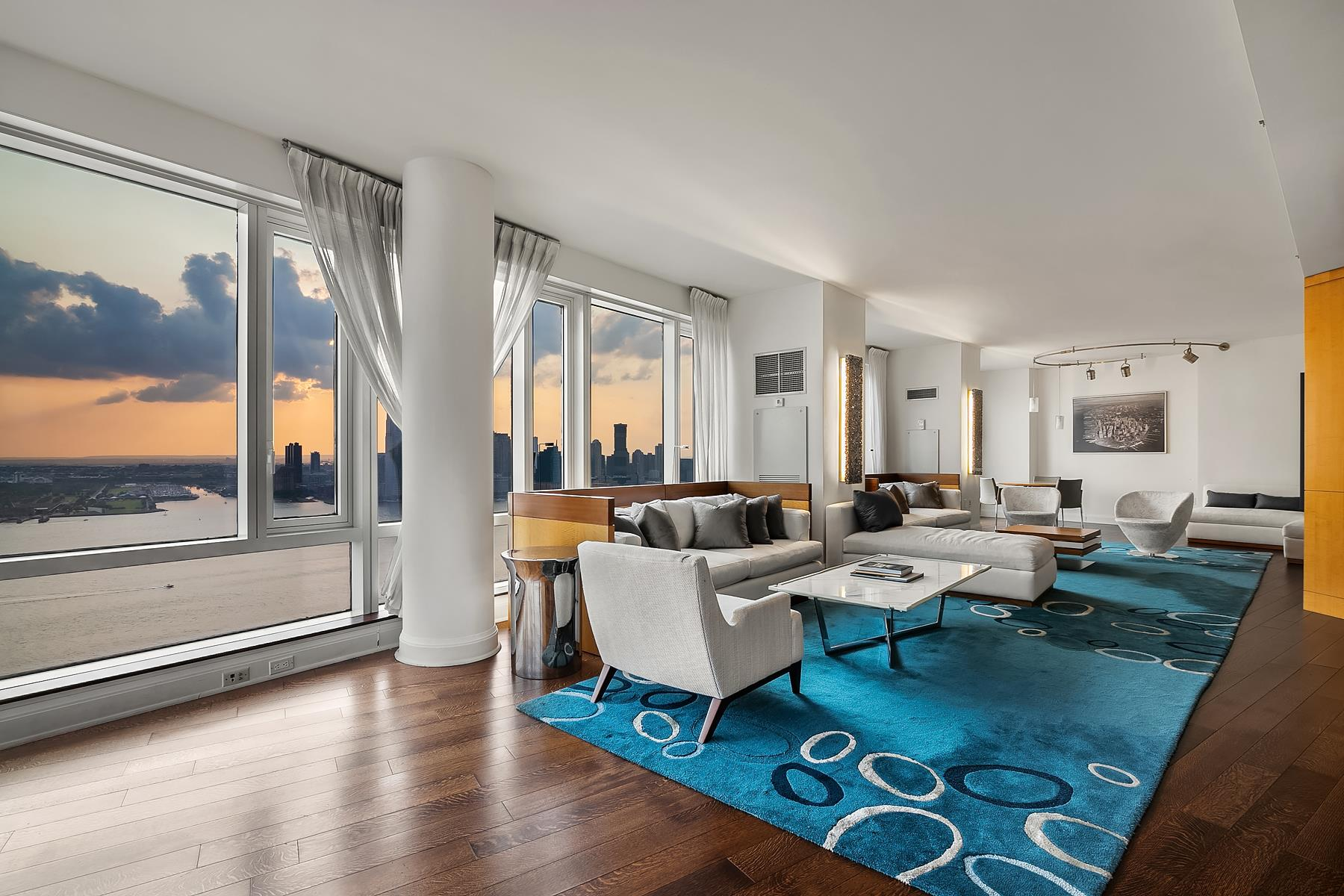 ICONIC STATUE OF LIBERTY & NEW YORK HARBOR VIEWS   THE VISIONAIRETHE RESIDENCEThis one-of-a-kind 3,418 SF sprawling residence is a unique combination of 70 Little West Street's most coveted high floor lines - D & E. This exquisitely finished apartment features a spacious dining room with direct Statue of Liberty views, walls of windows that ensure tons of natural light, hardwood floors, a generous closet space, and an in-unit washer and dryer. Currently, the apartment is configured as a 4 Bedroom 4.5 Bathroom unit with ample living space and a media room, and it can be easily converted into a 6 Bedroom residence.When you enter the apartment, you will be greeted by magic vistas of New York City Harbor and Hudson River! The oversized living and dining rooms are made for family and friends gatherings and dinners. Beautifully designed kitchen is outfitted with top-of-the-line appliances. The apartment is lit with natural light throughout the day with South, East, and West exposures. The residence has four spacious bedrooms, including the master bedroom with custom-made closets. In addition, the master suite offers a large en-suite bathroom that includes a walk-in shower, a deep soaking tub, and a double-sink vanity.THE BUILDINGDesigned by the world-renowned architects Pelli Clarke Pelli, The Visionaire at 70 Little West Street is the first high-rise residential building on the East Coast to receive LEED Platinum certification. State-of-the-art building's amenities include a sky-lit indoor pool, sauna, steam room, jacuzzi, a social lounge with TV and fireplace, children's playroom, fitness center, parking garage, and 24/7 concierge service. In addition, the landscaped terrace features gas grills, cabanas, and endless Hudson River views for comfort and relaxation. The Visionaire is the full-service luxury condominium where sustainable architecture meets art offering its residents a clean and healthy living environment with a high-efficiency air-filtration system, a centra