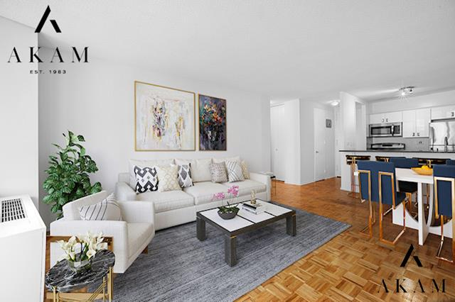 Welcome to your perfect new home at Madison Green - in the heart of Flatiron with every amenity at your doorstep!  Enjoy the Western light and city view from your private balcony, across from the iconic Flatiron Building and overlooking the plaza below. The open California kitchen features stylish white cabinetry, stainless appliances, granite counters and a convenient breakfast bar. Great closet space, including a nice walk-in!   You can luxuriate in your king-size bedroom, which is large enough to create a home office space as well. Madison Green is a highly sought-after building with luxurious amenities such as Full-time doormen, a fitness center, Madison Sky Club resident's lounge, children's playroom, laundry on every floor, bike room, storage, garage, live-in Resident Manager and onsite Property Manager.  Incredible location surrounded by Madison Square Park, Eataly, Fifth Avenue shopping, restaurants, multiple transportation options, and within close proximity to Union Square Farmer's Market, Whole Foods and Trader Joe's. *Some photos have been virtually staged.