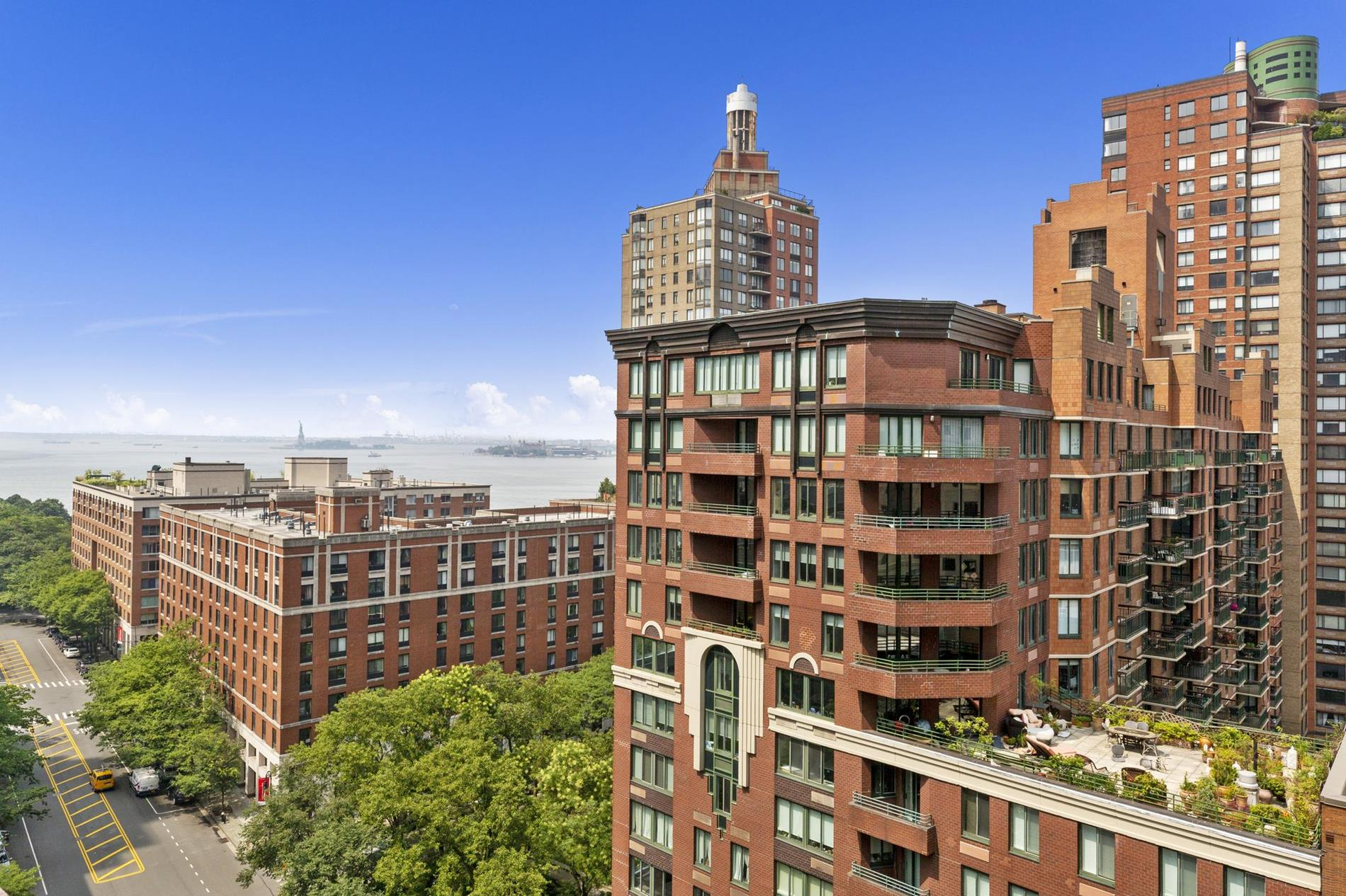 This amazing corner condo offers an outstanding opportunity to reimagine optimum downtown living. Wth incredible views, 11 windows and a prime Battery Park City address, this sun-splashed 2-bedroom, 1-bathroom home exemplifies indoor-outdoor living. An attached studio and a flexible 1,351 sq. ft. layout can also make the creation of a 3rd bedroom a reality.An expansive 1,221 sq. ft. terrace nearly doubles the size of the home and possesses protected views of the Hudson River and One World Trade Center. It is ideal for sun lounging, al fresco dining, and urban gardening, and it is perfect for enjoying magical sunsets all-year-round.Beyond a welcoming entryway adorned with a pair of coat closets, the home flows into a spacious open-concept living room, dining room, and kitchen saturated with natural light. The living room opens out onto the terrace, while the kitchen is equipped with an eat-in breakfast bar, sleek granite countertops, custom stainless steel cabinets, and a suite of high-end stainless steel appliances. Both bedrooms come with private closet space.Additional highlights include rich stone floors, a washer/dryer hookup, oversized sliding windows, and an adjacent studio with a private entrance and a full kitchen.Hudson View East is a full-service condominium located in Battery Park City. The building has 24-doorman and staff, a live-in super, a tranquil courtyard with grilling stations, common laundry on every floor, a bicycle room, and private storage. It is close to many local schools, and it is moments from the Hudson River Esplanade, Brookfield Place, Westfield Mall, Oculus Center, The Battery, One World Trade Center, and the Financial District. Nearby subway lines include the 1/2/3/4/5/R/W/E/J/Z. Pets are welcome.14AF has been virtually staged
