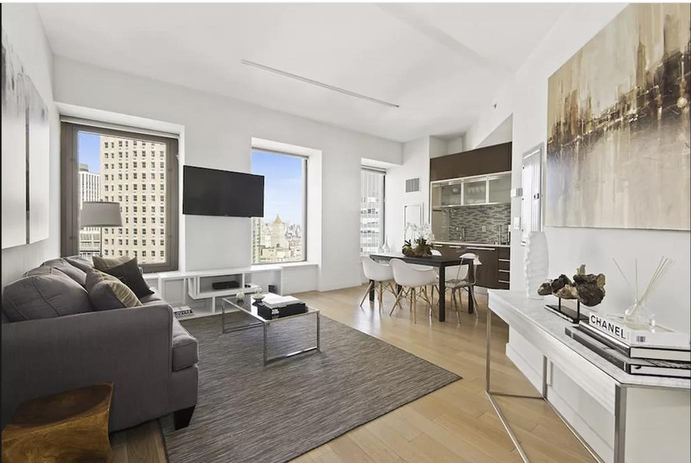 OPTION TO BUY IN BITCOINCorner two-bedroom two-bathroom atop the 38th floor in the historic neighborhood of Financial District offers quintessential downtown living. The highlights of the apartment are the 10-feet ceilings, river view, and top of the line finishes in a world-class amenity-rich building. Upon entering, one is greeted by an open kitchen and 6-feet oversized windows, which capture sunlight through the north and west exposures. The custom chef's kitchen is outfitted with high-end appliances such as a SubZero refrigerator, Bosch dual ovens, Bosch five burner range, and a Miele dishwasher. The master bedroom features river views and a walk-in-closet. The master bathroom contains a glass-enclosed standing shower, deep soaking tub, marble floors, dual vanity, and a black granite countertop. There is wide-plank oak wood flooring throughout the apartment and a stackable in-unit washer dryer.The fitness center features Peloton bikes and offers free yoga classes throughout the week. The building features over 30,000 SQFT of amenities including a state-of-the-art fitness center, yoga studio, billiards room, cinema room, children's playroom, parking garage, housekeeping services, 24-hour concierge, cold storage, bicycle storage, and on-site management. The wraparound roof terrace offers sensational views of the skyline and is an ideal place to meet fellow residents of the building. The in-house Andaz restaurant provides room service to residents and the Luxury Attache personal concierge is a value added perk.75 Wall is situated in close proximity to Brookfield Place (Hermes, Burberry, Bottega Veneta, etc), Eataly, and the historic Seaport district (Pier 17, South Street Museum, Fulton Stall Market). The building is centrally located near all major transportation 2, 3, 4, 5, A, C, J, Z trains, PATH, water taxi, heliport, and the FDR
