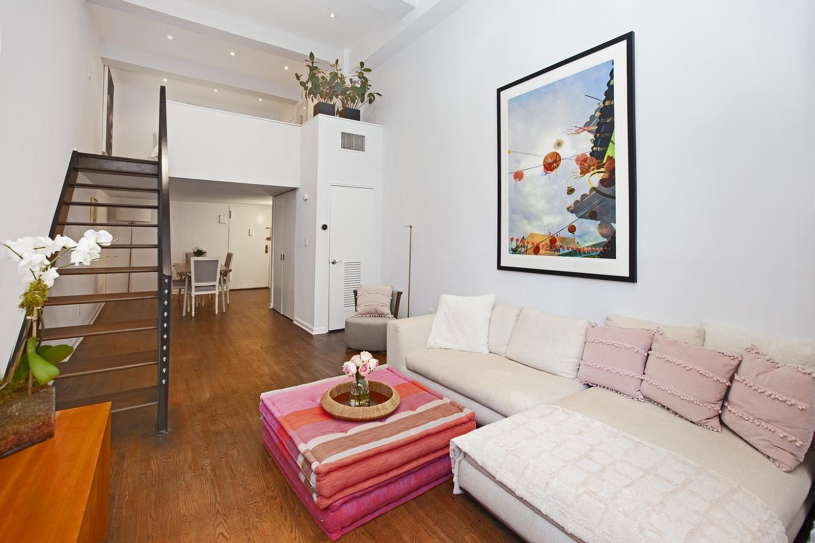 Soaring 15 foot ceilings greet you as you enter this stunning duplex nestled on the 5th floor of the iconic Printing House in the coveted West Village! As you enter your new home, you will find a fully equipped chefs kitchen to the left, complete with gas range, oven and dishwasher, custom cabinetry and granite countertop. To the right you will find a spacious dining area, roomy enough to accommodate a large dining table with seating for 8-10! Continue past the large closet and beautiful guest bath into to the jaw dropping living room with double height windows and contemporary staircase leading to the king sized, pin-drop quiet bedroom featuring home office, expansive walk in closet, and private bath with shower and linen cabinet.The Printing house is a full service luxury condominium with low maintenance fees, concierge and valet located in the heart of the West Village on Hudson and Leroy Streets, surrounded by parks, restaurants, nightlife, premiere shopping, the Hudson River Esplanade and everything the amazing West Village has to offer!In addition, the flagship Printing House Equinox Gym is located within the building, complete with legendary outdoor swimming pool on the roof!