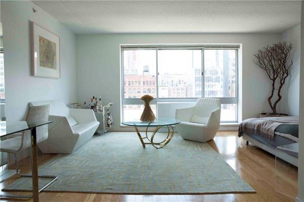 Large Alcove Studio with Huge Picture Floor to Ceiling Window.  Granite and Stainless Kitchen with GE Profile Appliances inc DW & Micro.  Generous Walk In Closet, Stunning Marble & Granite Bath with Espresso Vanity and Hotel Style Dornbracht Fixtures.   555 W 23rd is an Amenity Packed Full Service Building featuring a Doorman, Front Desk Reception and Hotel Style Concierge Service, On Site Catering by Marcy Bloomstein.  Available Garage (Fee) with Zip Car, Huge Planted Sundeck with Water Fountains, Residents Lounge with WiFi, Fireplace,Pool and Game Tables.  Steps from Chelsea Cove Park, The Highline and Chelsea Piers Sports Complex.